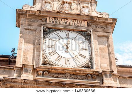 Clock on the tower of Giureconsulti palace in the center of Milan