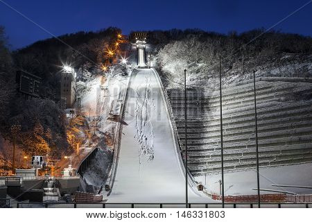 Sapporo Hokkaido JAPAN - December 12 2011: View of ski jump resort from the below of Mt. Okura in moments of twilight time in winter at Sapporo Hokkaido Japan