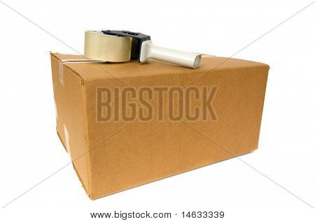 Shipping Box with a tape gun on top on white background, space for copy on box or around box