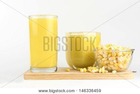 Closeup fresh sweet corn juice (corn milk) isolated on white background.