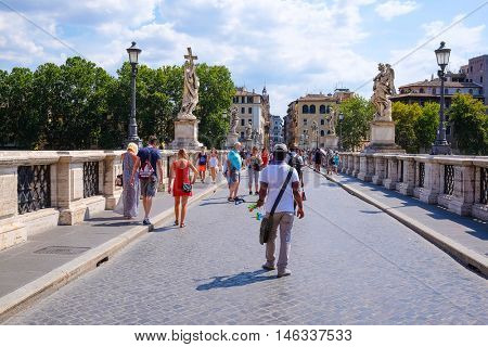 Roma, Italy - August, 7, 2016: people on a bridge from Tiber in Roma, Italy