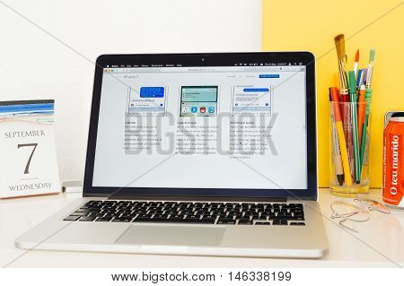 PARIS FRANCE - SEP 8 2016: Apple Computers website on MacBook Pro Retina in a geek creative room environment showcasing Calendar Suggested apps and Multilingual Typing on ios 10