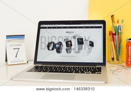 PARIS FRANCE - SEP 8 2016: Apple Computers website on MacBook Pro Retina in a geek creative room environment showcasing showcasing the Apple Watch series 2