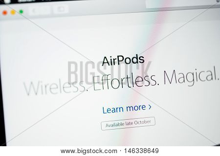 PARIS FRANCE - SEP 8 2016: Tilt-shift lens over Apple Computers website on MacBook Pro Retina in a geek creative room environment showcasing AirPods Wireless Effortless Magical