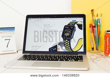 PARIS FRANCE - SEP 8 2016: Apple Computers website on MacBook Pro Retina in a geek creative room environment showcasing new Apple Watch Series 2 with built-in GPS