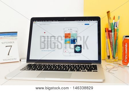 PARIS FRANCE - SEP 8 2016: Apple Computers website on MacBook Pro Retina in a geek creative room environment showcasing new Apple Watch Series 2 with health app on iphone