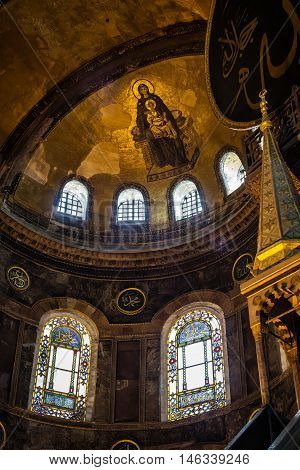 ISTANBUL TURKEY - APRIL 15 2015 : Painted Madonna with baby Jesus on ceiling in Hagia Sophia ancient basilica. Hagia Sophia served as a model for many other Ottoman mosques