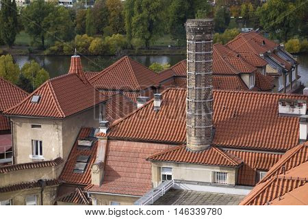 Orange tiled roos of the residential block in Vysehrad, Prague, Czech Republic on sunny October afternoon.