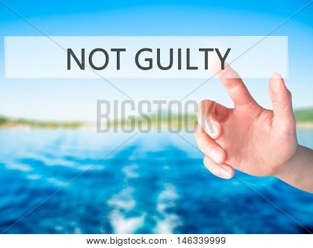 Not Guilty - Hand Pressing A Button On Blurred Background Concept On Visual Screen.