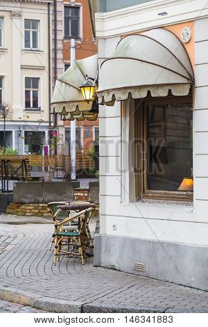 A small cozy cafe on the corner of the street. Riga. Latvia