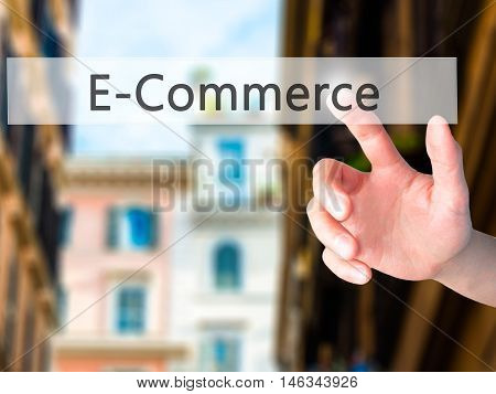 E-commerce - Hand Pressing A Button On Blurred Background Concept On Visual Screen.