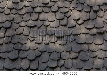 old hand made roof made from black wood wooden roof.cedar roof