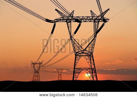 Electricity pylons and lines at dusk.