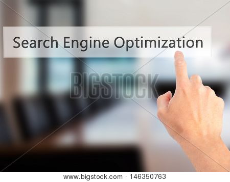 Search Engine Optimization - Hand Pressing A Button On Blurred Background Concept On Visual Screen.