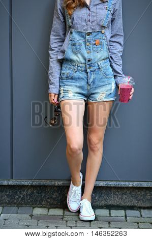 Woman With A Smoothie In Disposable Cup. Healthy Lifestyle