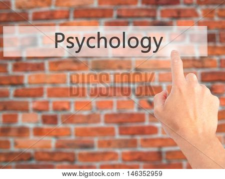 Psychology - Hand Pressing A Button On Blurred Background Concept On Visual Screen.