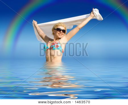 Happy Girl With Towel Standing In Water