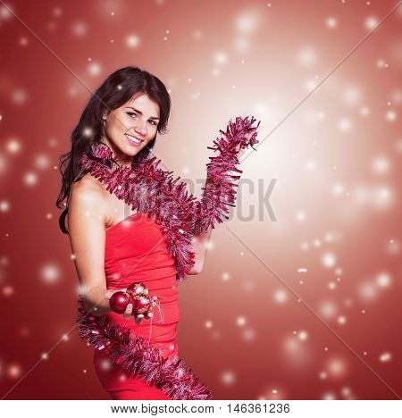 beautiful young woman in red dress with Christmas garland on a Christmas background