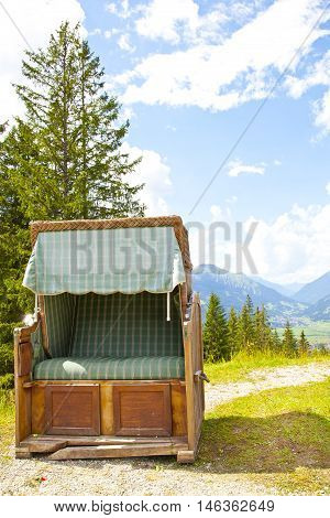 View at vintage old chair near Ehrwalder Almsee with mountain landscape Tirol Austria