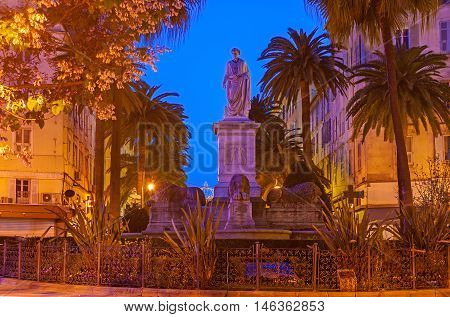 The monument to Napoleon Bonaparte in Foch Square in bright evening lights Ajaccio Corsica France.
