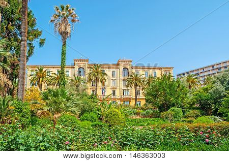 The lush garden hides the scenic mansion of Corsican Assembly that has it seat in Grand Hotel d'Ajaccio et Continental Corsica France.