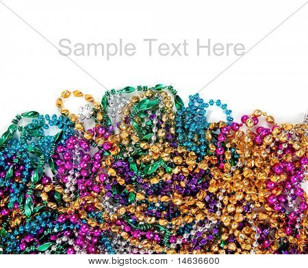 Multi colored mardi gras beads including blue, green, purple, pink, yellow and gold on a white background with copy space
