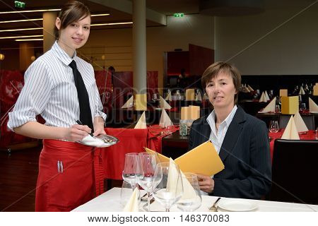 young waitress listed order of the guest