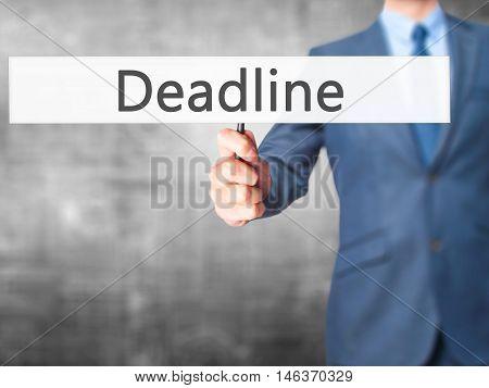 Deadline - Businessman Hand Holding Sign