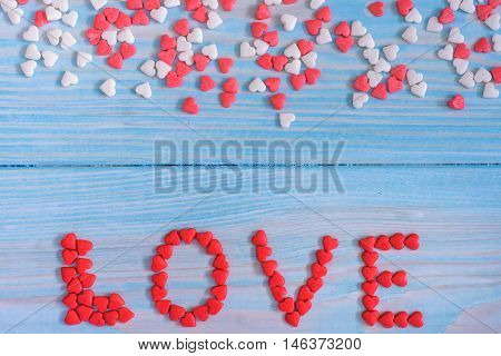 Red Candy Hearts Laying On Light Blue Painted Rustic Wooden Background