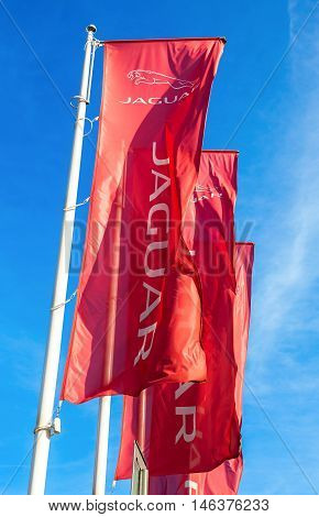SAMARA RUSSIA - AUGUST 27 2016: Official dealership flags of Jaguar against the blue sky background. Brand of the British multinational car manufacturer Jaguar Land Rover owned by Tata Motors