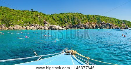 View from the tour boat to the Similan Island Andaman Sea Thailand. Couple snorkeling and diving in crystal blue water.