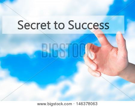 Secret To Success - Hand Pressing A Button On Blurred Background Concept On Visual Screen.