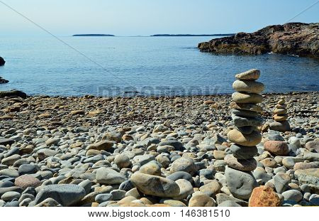 2 inukshuks or cairns on Cobbling the Cove beach in Acadia National Park