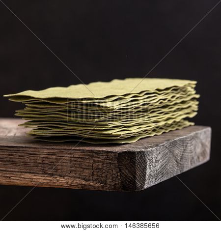 lasagne sheets on a wooden board