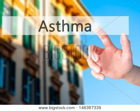 Asthma - Hand Pressing A Button On Blurred Background Concept On Visual Screen.