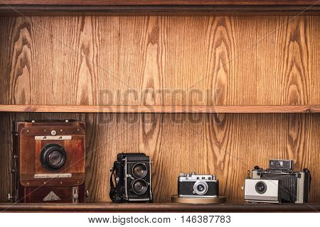 Photographer locker with old fashioned cameras. Black and white photography