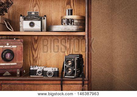 Photographer's locker with photography retro equipment. Polaroid camera medium format camera large format camera. Traditional photography. Black and white photography.