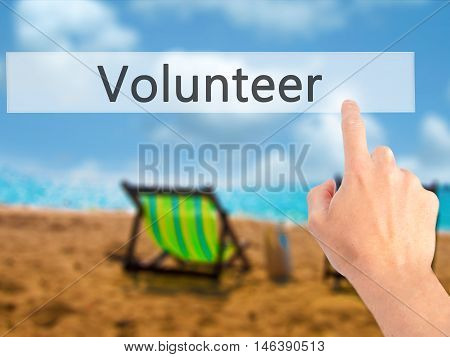 Volunteer - Hand Pressing A Button On Blurred Background Concept On Visual Screen.