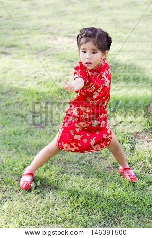 Asian Girl In Red Dress