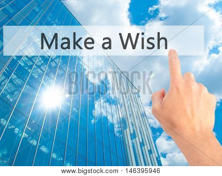 Make A Wish - Hand Pressing A Button On Blurred Background Concept On Visual Screen.