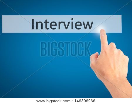 Interview - Hand Pressing A Button On Blurred Background Concept On Visual Screen.