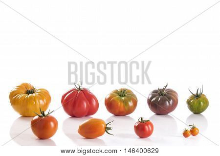 Variety of Heirloom tomatoes on white background