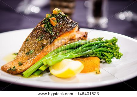 Grilled salmon on roasted mash potato with asparagus