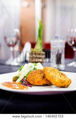 Romantic dinner - lovely plate of fishcakes in a stylish restaurant