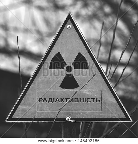 Sign of radioactivity. Abandoned Industrial Area. Ukraine