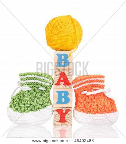 Bright little bootee with playing cubes isolated over white background