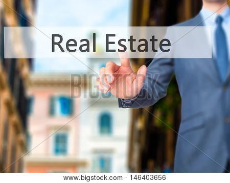 Real Estate -  Businessman Click On Virtual Touchscreen.
