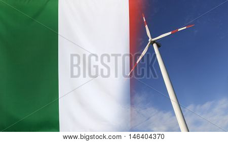Concept clean energy with flag of Italy merged with wind turbine in a blue sunny sky