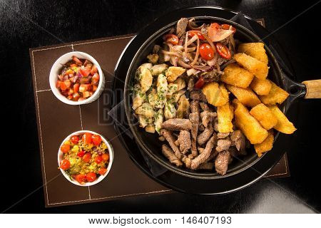 Portion Of Meat With Fries And Fried Yucca