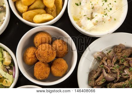 Mixed Brazilian Snacks, Including Pastries, Fried Chicken, Salads, Soups, Fries, Kibe .